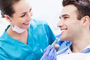 Dental Hygienist With Dental Patient